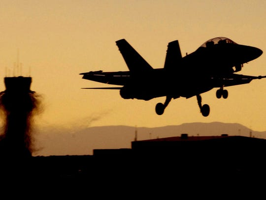FILE PHOTO: An F-18 Hornet takes off for a night mission from NAS Fallon in 2006.