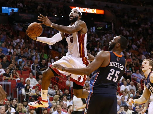 LeBron James put on a show at American Airlines Arena in Miami, pouring in a career-high and Heat record 61 points in a 124-107 win over the Charlotte Bobcats.