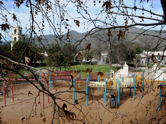 A couple of children and their parents play at Libbey Park with the Ojai Arcade and the mountains in the background. Ojai officials are in the early talks to replace the playground equipment at Libbey Park.