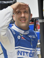 Tony Kanaan glances at the scoring pylon to check competitor's speeds before his first laps on the opening day of practice at the Indianapolis Motor Speedway on May 16, 2016.
