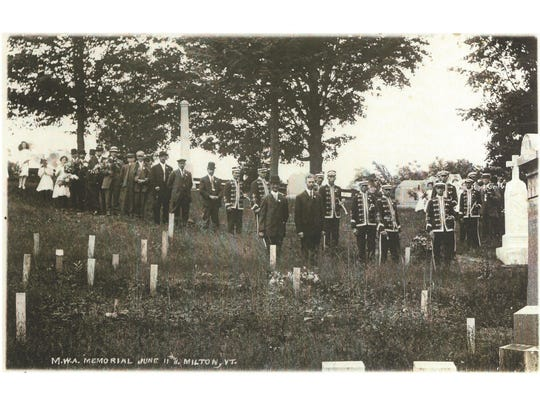 A photo from 1911 shows a ceremony performed in the Village Cemetery on Main Street in Milton.