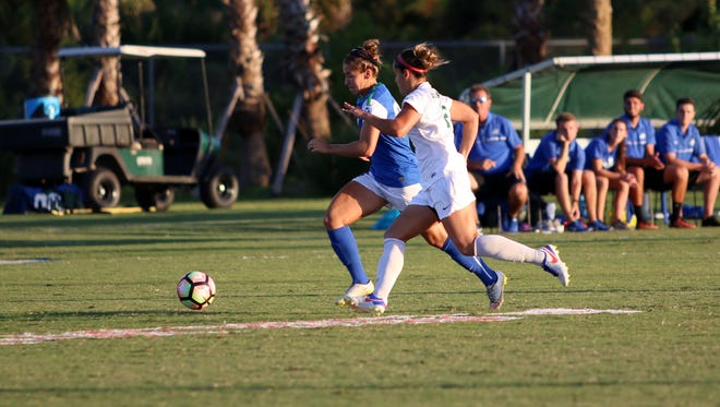 Senior Tabby Tindell fights for possession during Monday night's last home game against Stetson.