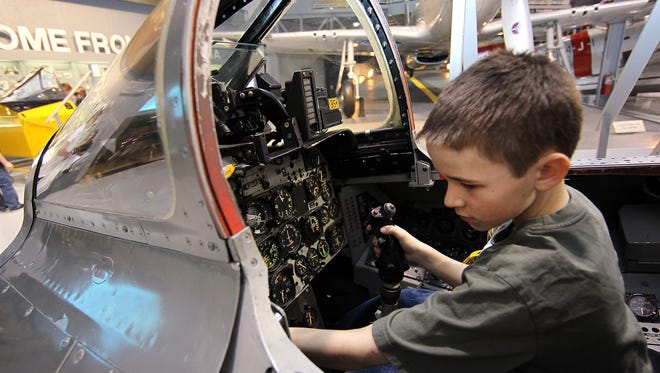 Bryce Barnes sits inside an F-100 cockpit trainer at Family Flight Fest at the EAA Aviation Museum in this file photo. This year's event is March 10 and 11.