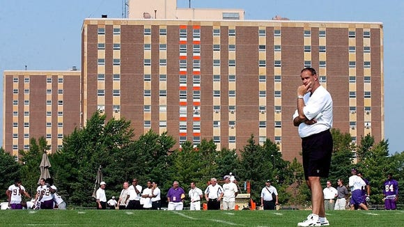 Former Vikings coach Mike Tice on the practice field in Mankato, where the team has held training camp since 1964.