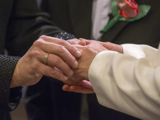 The ring exchange is shown during the Indiana marriage