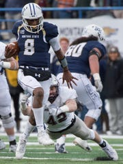 Montana State quarterback Chris Murray high-steps for