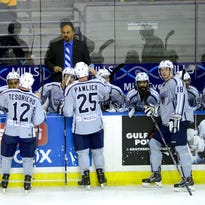Pensacola Ice Flyers meet with head coach Rod Aldoff during a break Wednesday in a game against the Louisiana IceGators at the Pensacola Bay Center.