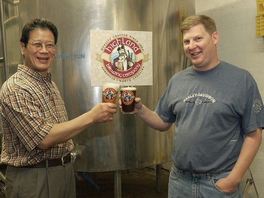 Highland Brewing was once located in the basement level of the Barley's Taproom and Pizzeria in Asheville. Today, it's in the old Blue Ridge Motion Picture studio. Pictured are founder Oscar Wong (left) and brewmaster John Lyda in the old Barley's location.