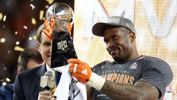 Denver Broncos outside linebacker Von Miller (58) celebrates with the Vince Lombardi Trophy after being named the Super Bowl MVP after beating the Carolina Panthers in Super Bowl 50 at Levi's Stadium.
