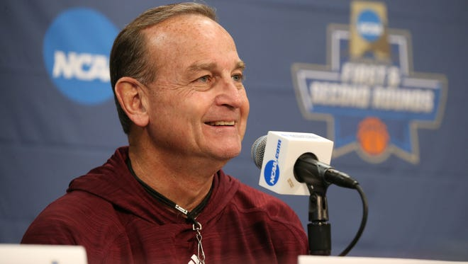 Vic Schaefer answers a question during a press conference for the NCAA Tournament.