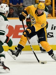 Predators left wing Kevin Fiala (22) shoots past Wild
