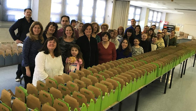 Members of Temple Emanuel of the Pascack Valley gather together for the mass production of more than 600 baskets for distribution to members and friends in the Pascack and Saddle River community in celebration of the Jewish holiday of Purim. The baskets enable members of the synagogue to share their joy of the holiday with friends and family and to make a donation to a non-profit organization, Mazon, that supplies food to hungry people of all faiths and backgrounds.
