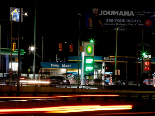 A time exposure showing gas stations that are part