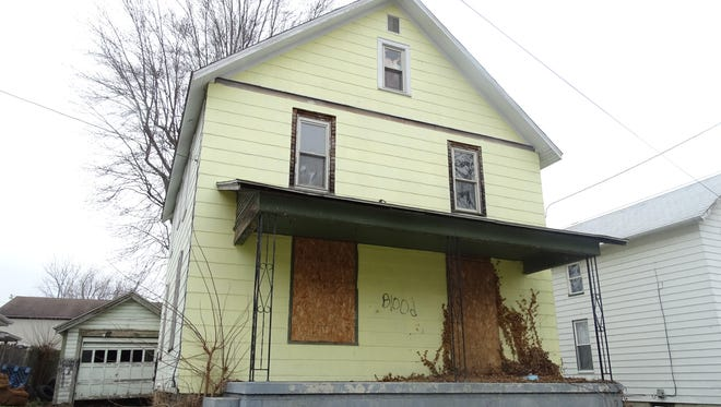 This abandoned home at 115 Fisher St. in Bucyrus is one that the city hopes to soon transfer to the county's land bank. City council will consider legislation Tuesday that will make that transfer happen more quickly.