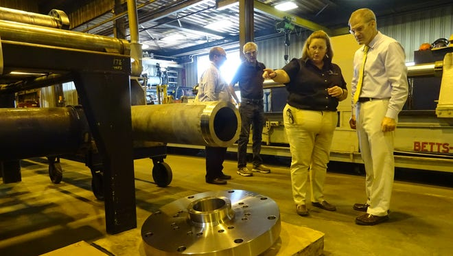 Annie Carter shows US Rep. Jim Jordan around her Galion factory on Monday.