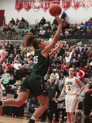 Tihanna Fulton of Mason puts in an off-balance layup for two points.