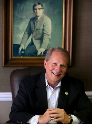 Sen. Bill Ketron Jr. announces that he will be running for County Mayor, on Tuesday June 20, 2017. Ketron is sitting infront of a photograph of his father Bill Ketron Sr.