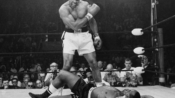 Muhammad Ali stands over fallen challenger Sonny Liston, May 25, 1965. Credit: John Rooney/AP
