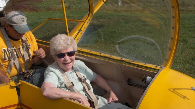 Kay Perkins' high spirits often sparked adventures, such as flying in this glider.