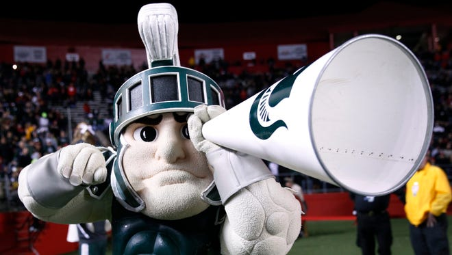 Sparty uses a cheerleader megaphone as a telescope during a game against Rutgers on Saturday, Oct. 10, 2015, in Piscataway, N.J.