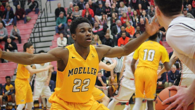 Moeller guard Trey McBride plays defense in the Crusaders' 61-58 overtime victory over Oak Hills in a Division I sectional final at Fairfield on Friday night.