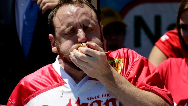 Joey Chestnut devours some hot dogs during the 2016 contest.