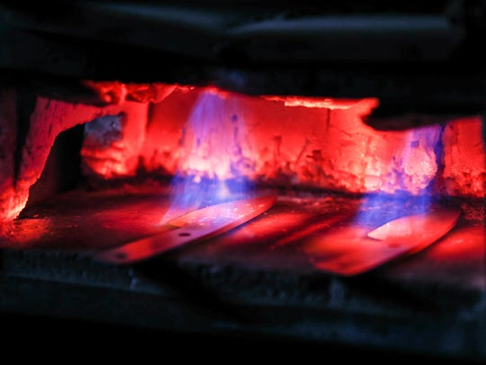 James Wahls Sr. heats custom knife blanks in a forge
