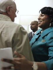 Mayor Lovely Warren greets outgoing Mayor Tom Richards after her public inaugural ceremony on Jan. 4.
