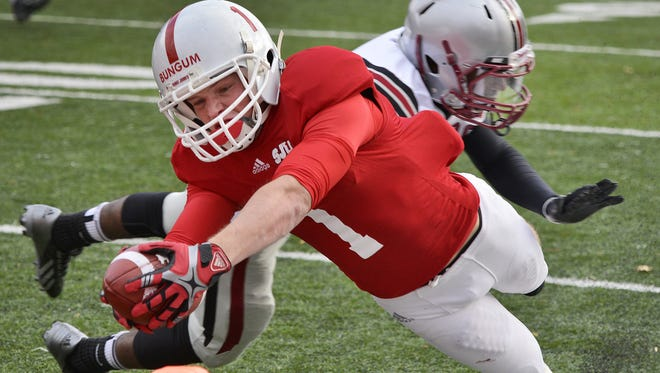 St. John's Josh Bungum dives for the goal line to score the Johnnies' second touchdown against the Hamline Pipers in the third quarter Saturday at Clemens Stadium. St. John's beat Hamline 20-14.