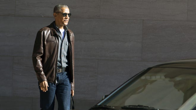 Former president Barack Obama leaves the National Gallery of Art in Washington on March 5, 2017.