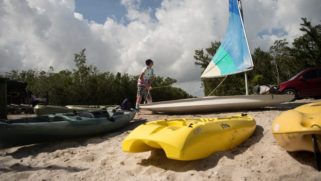 Nicolas Davidson, 16, of Vero Beach, prepares to sail on the Indian River Lagoon on Sunday, Feb. 11, 2018, in Vero Beach. Davidson's group of family and friends met at the Oslo Road boat ramp to go fishing on the lagoon.
