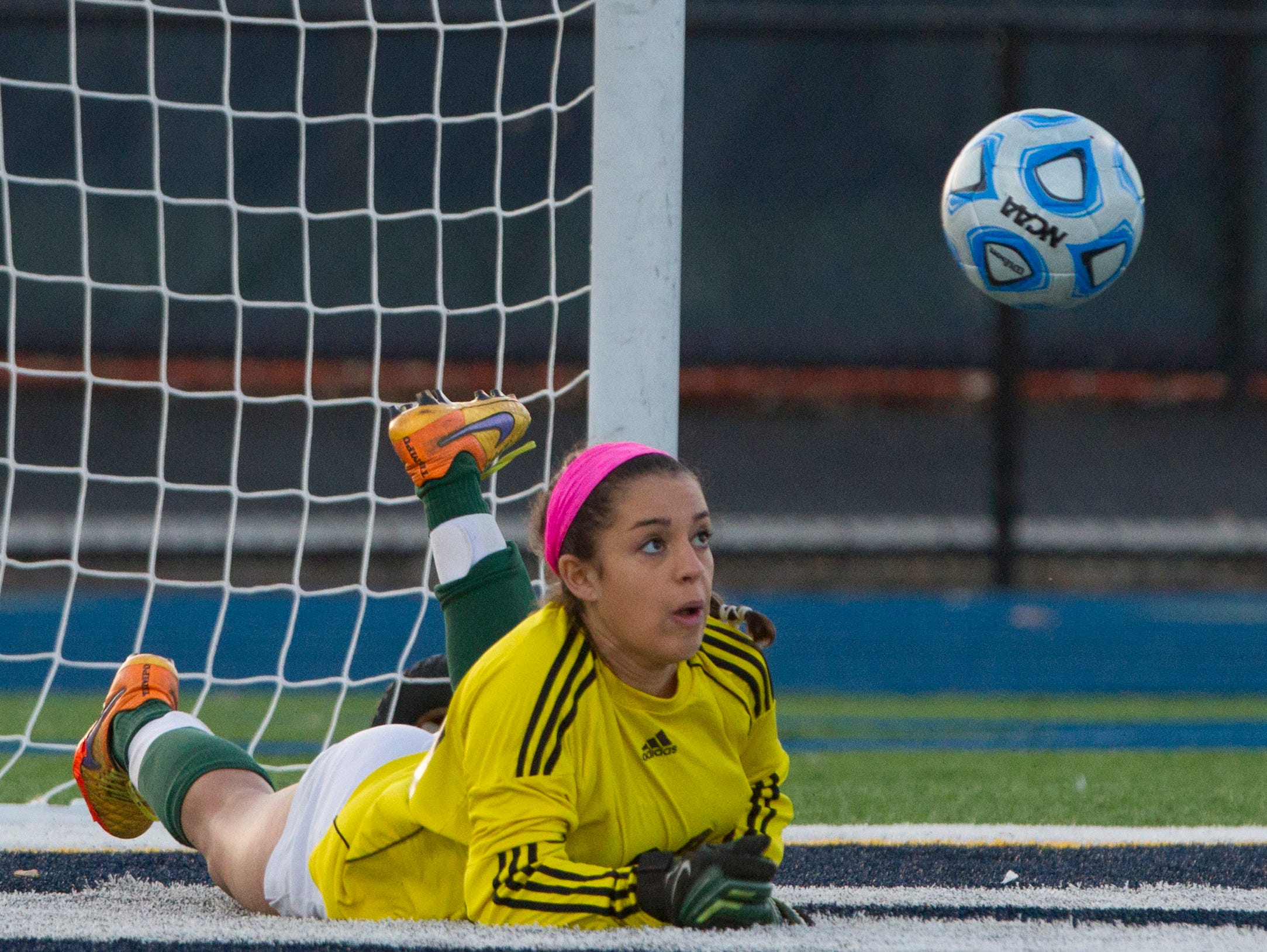 Colts Neck goalie Lauren Feaster looks up at shot on goal during closing moments of game that she blocked and got kicked away by a teammate. Colt Necks Girls Soccer vs Northern Highlands in NJSIAA State Group III Championship at Kean University on November 21, 2015 in Union, NJ.