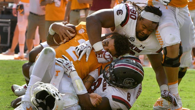 Tennessee quarterback Jarrett Guarantano (2) has his helmet ripped off as he is sacked during the Vols' 15-9 loss to South Carolina last season.
