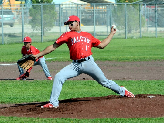 Loving's Jordan Piña fires a pitch in the top of the first inning Tuesday against Dexter.
