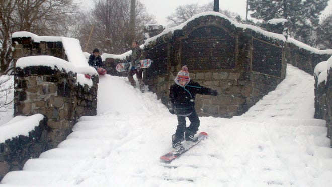 Edwin Linsares, 11, snowboards down stairs at Memorial Park in Nyack Feb. 9, 2017. He, along with friends Jack Flint-Bradbury, 12, and Augie Davi-Fiondella, 11, made the most of their snow day by heading outside as the worst of the winter storm made its way out of the region.
