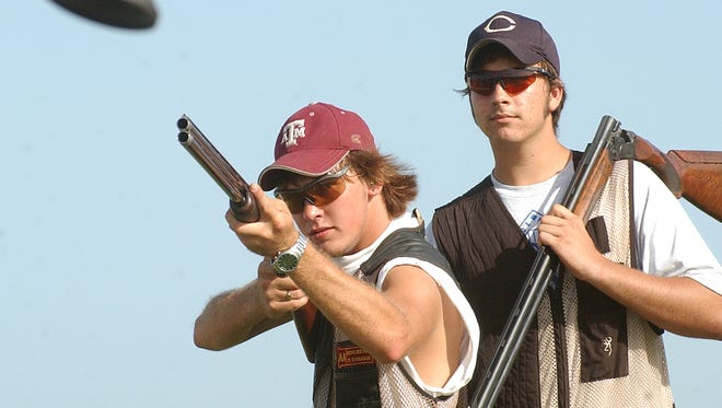 P-1FourHchamps----- Josh Parks, age 17, left;  and Donny Netek, age 15, right;  practice this week for this weekend's Texas State 4 H shooting championships in San Antonio.  Parks, a senior at C.C. Academy high school and Netek is a sophomore at Carroll H.S.  Parks shooting in senior division and Netek in the junior divisions combined have won severeal major titles for the Nueces Co. shooting team in Skeet, Trap, international events and 5-Stand competition this month.  The state 4 H competition at the National Shooting Complex in San Antonio begins Thursday thru Sunday.   The shooting team practices at the  Corpus Christi Gun Club.  7-14-04