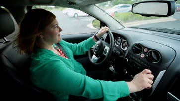 Kim Eberhardt, 35, of Beverly Hills, turns her car radio on after leaving work on Friday, July 8, 2016, outside of her office in Farmignton Hills. Eberhardt is a fan of the new 105.1 FM, The Bounce, and listens to it in her car.