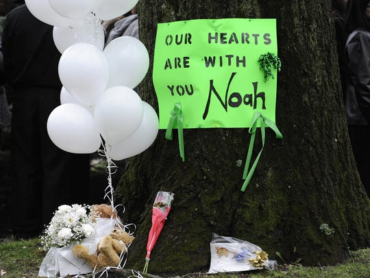 A memorial for Noah Pozner outside his funeral in Fairfield,