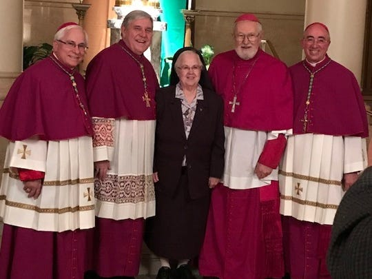 Pictured are, from left: Bishop Jeffrey Haines, Archbishop