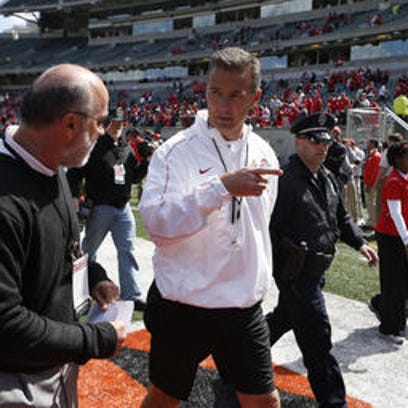 Urban Meyer, shown here at the OSU spring game at Paul Brown Stadium in 2013, will bring the Buckeyes back to Cincinnati to be honored by the Reds.