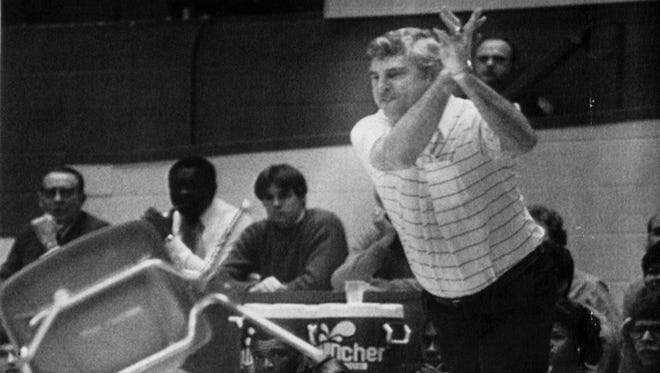 Bob Knight famously tosses a chair across the court during an IU-Purdue game in February of 1985.