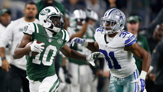 Jets receiver Kenbrell Thompkins (10) eludes Cowboys defender Byron Jones (31) after fourth-quarter catch.