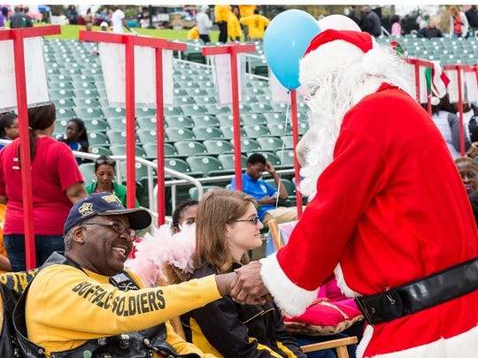 Santa shakes hands with those enjoying the rocking chairs at Cascades Park during 2014's Rock-A-Thon.