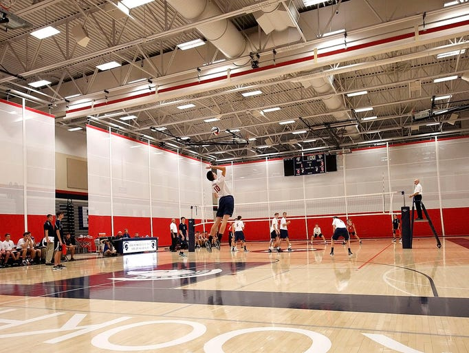 Brookfield East's Jacob Sirny leaps up to serve against