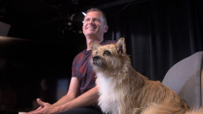 Dion Leonard and his dog, Gobi, prepare for an interview in New York on June, 14, 2017.