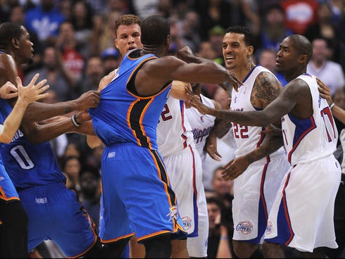 Serge Ibaka and Matt Barnes are separated during Wednesday's scuffle at Staples Center.