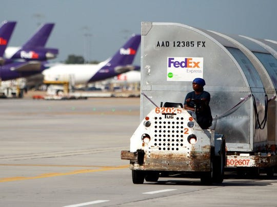 Shipping containers hold cargo at FedEx Memphis World Hub. Executives with FedEx, the area's largest employer, expect to close on the $4.9 billion purchase of Netherlands-based TNT Express in the first quarter of 2016. The acquisition will position FedEx as one of Europe's largest parcel haulers. (Mike Brown/The Commercial Appeal)