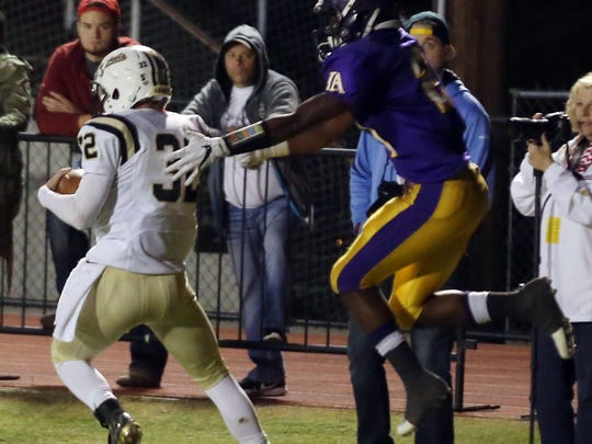 Springfield's Bryan Hayes intercepts a pass intended for Lipscomb Academy's William Phillips during their playoff game at Lipscomb Academy Friday November 4, 2016.