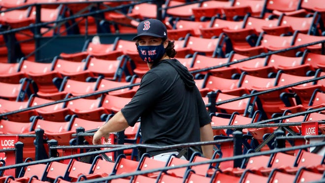 Red Sox left fielder Andrew Benintendi walks through the stands during practice at Fenway Park.