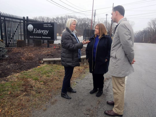 Linda Puglisi, supervisor of the Town of Cortlandt, left, Theresa Knickerbocker, mayor of the Village of Buchanan, and Joseph Hochreiter, superintendent of the Hendrick Hudson School District, talk outside the entrance to the Indian Point nuclear power plant Jan. 17, 2017. Officials of the town, village and school district are now challenged with finding ways to make up the revenue that will be lost when Indian Point closes in 2021.